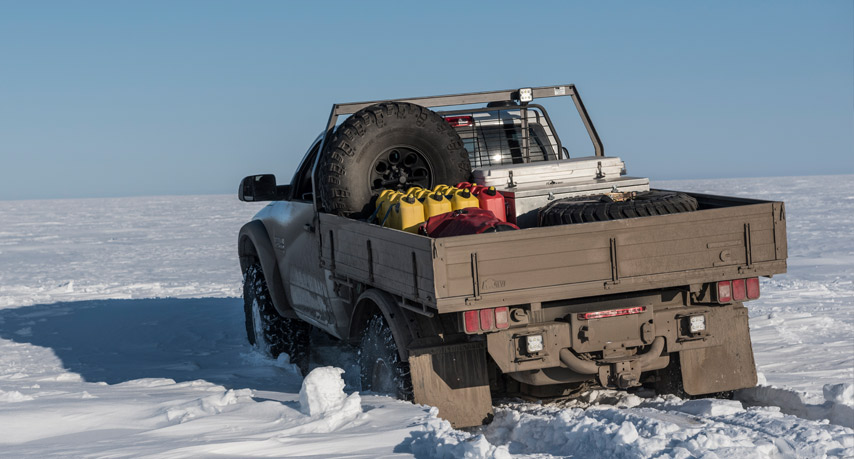 AEV Prospector XL Tray Bed loaded with a equipment on its way to the Arctic circle.